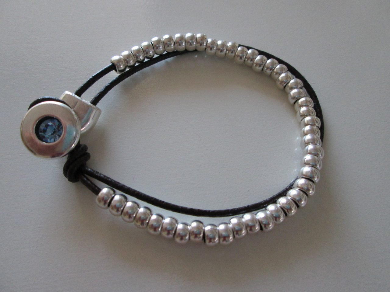 BRACELET IN ZAMAK WITH BEADS AND LEATHER