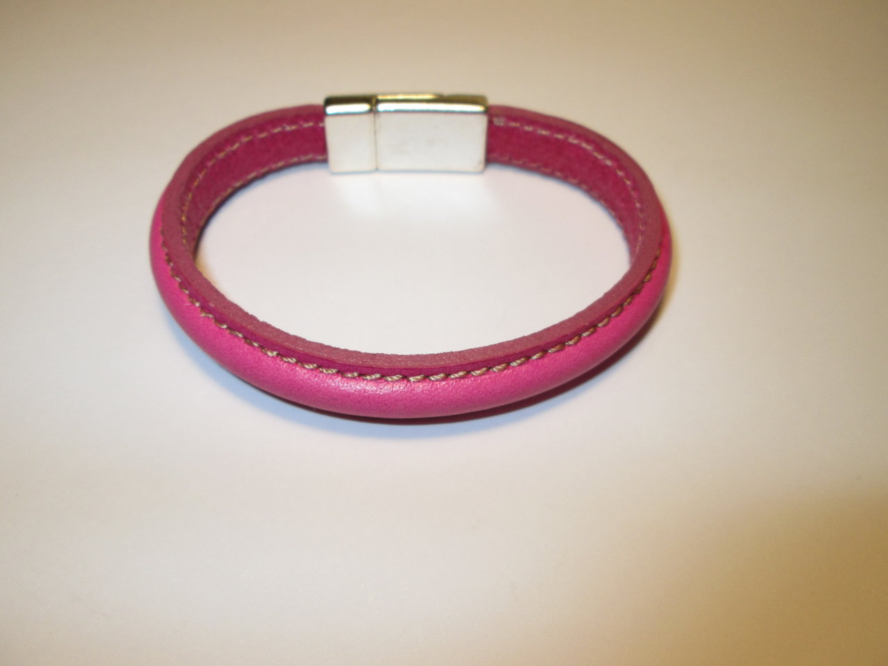 LEATHER PINK BRACELET IN ZAMAK