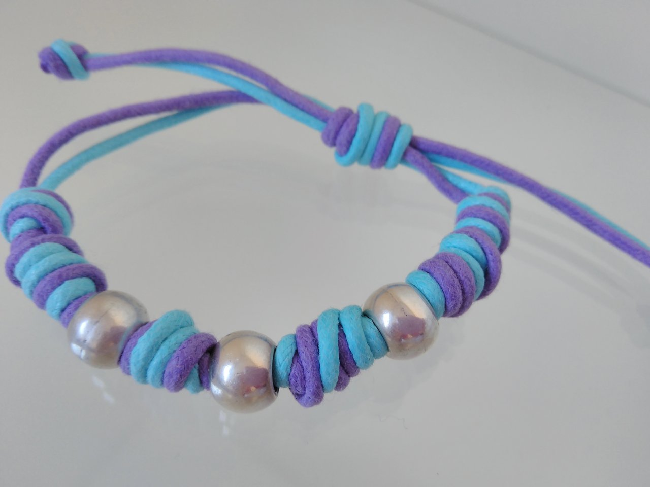 DOUBLE CORD BRACELET WITH ZAMAK BEADS