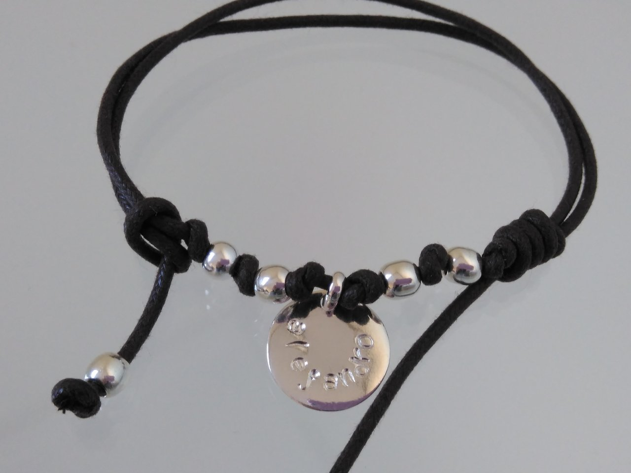 SILVER BRACELET WITH ONE MEDAL